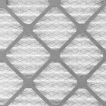 Top 3 FAQs About Furnaces- Close up pattern of a furnace filter