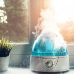 Small air humidifier is on and steam comes from the top.