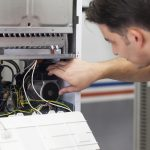 Technician servicing HVAC system