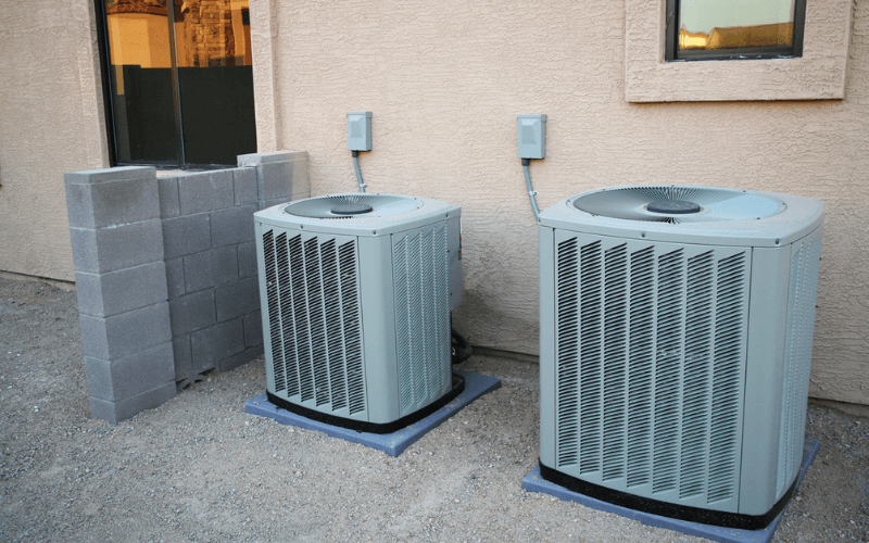 if you are selling your house your HVAC can impact your home value. Two air conditioners side by side, one new and one old.